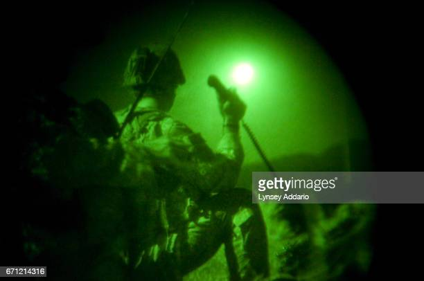 American soldiers with the 173rd battle company on a battalionwide mission in the korengal valley Afghanistan Through nightvision goggles JTAC Kevin...