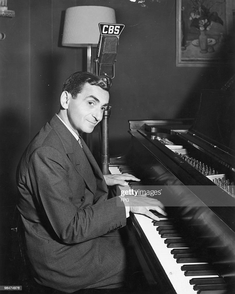 American songwriter and composer <a gi-track='captionPersonalityLinkClicked' href=/galleries/search?phrase=Irving+Berlin&family=editorial&specificpeople=208654 ng-click='$event.stopPropagation()'>Irving Berlin</a> (1888 - 1989) performs for a CBS Radio show, circa 1935.