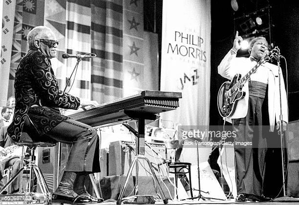American soul and RB musician Ray Charles left plays electric piano as he performs onstage with Blues musician BB King at the Apollo Theater New York...