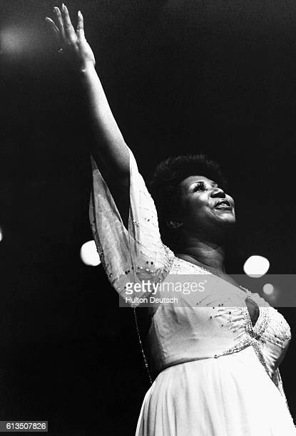 American Soul Singer Aretha Franklin on stage Aretha Franklin successful American soul singer gained fame with hit songs such as 'Respect'