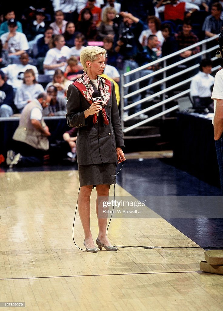 American sports journalist Mimi Griffin analyst for ESPN holds a microphone on the court before a women basketball game of between the universities...