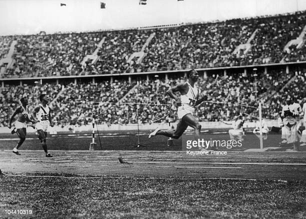 American sprinter Jesse Owens crossing the finish line of the 200m dash on August 5th 1936