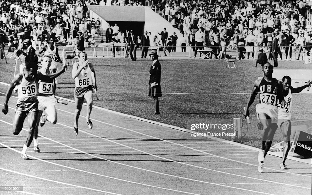 American sprinter Jim Hines (#279) finishes first in the men's 100 meter relay, setting a world record with his teammates (not pictured) Charlie Greene, Mel Pender, and Ronnie Ray Smith, Mexico City, Mexico, October 21, 1968. Enrique Figuerola of Cuba finishes second (far right), Lennox Miller of Jamaica (#536) finished fourth, Germany's Harald Eggers (#63) finished fifth, and Poland's Marian Dudziak (#666) finished eighth.