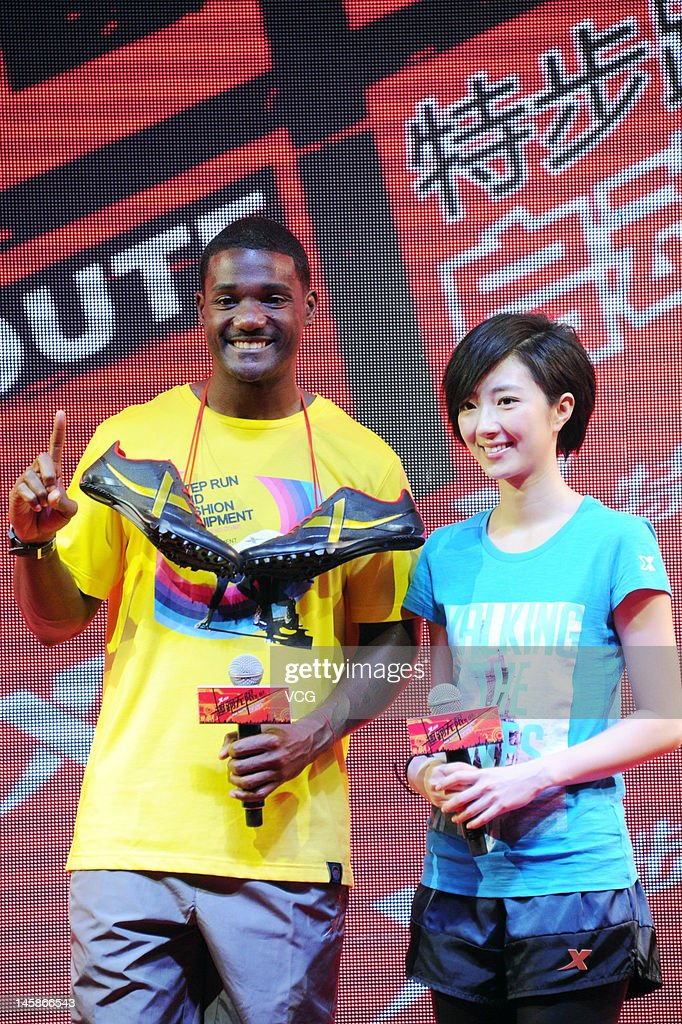 American sprinter <a gi-track='captionPersonalityLinkClicked' href=/galleries/search?phrase=Justin+Gatlin&family=editorial&specificpeople=162752 ng-click='$event.stopPropagation()'>Justin Gatlin</a> and actress Kwai Lun-Mei attend Xtep promotional event at 798 Art Zone on June 6, 2012 in Beijing, China.