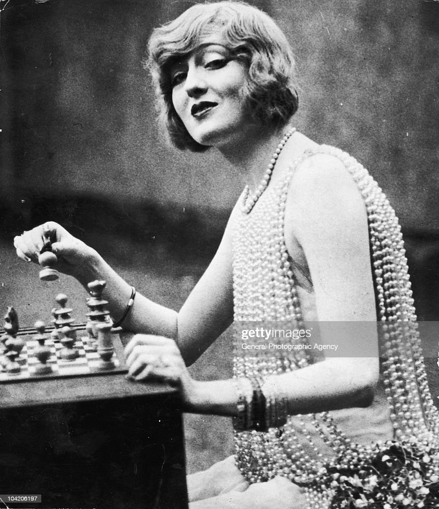 American stage actress and socialite Peggy Hopkins Joyce (1893 - 1957), playing chess, circa 1925.