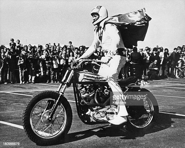 American stunt person Evel Knievel on a Harley Davidson motorcycle circa 1975