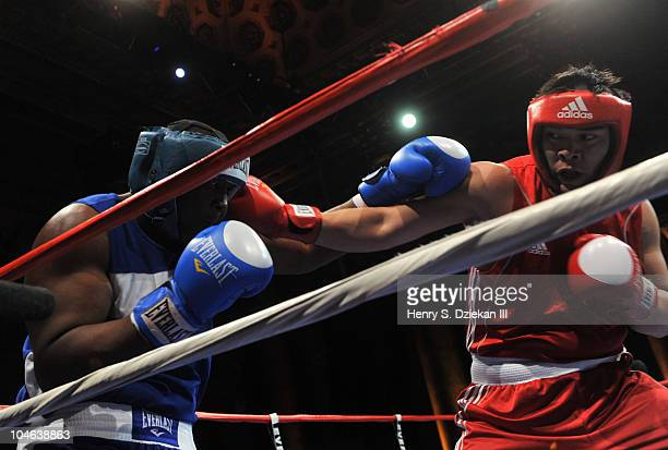 American Super Heavyweight Boxer Danny Kelly and Chinese super heavyweight boxer Zhang Zhilei compete at Empires Collide China vs USA amateur boxing...