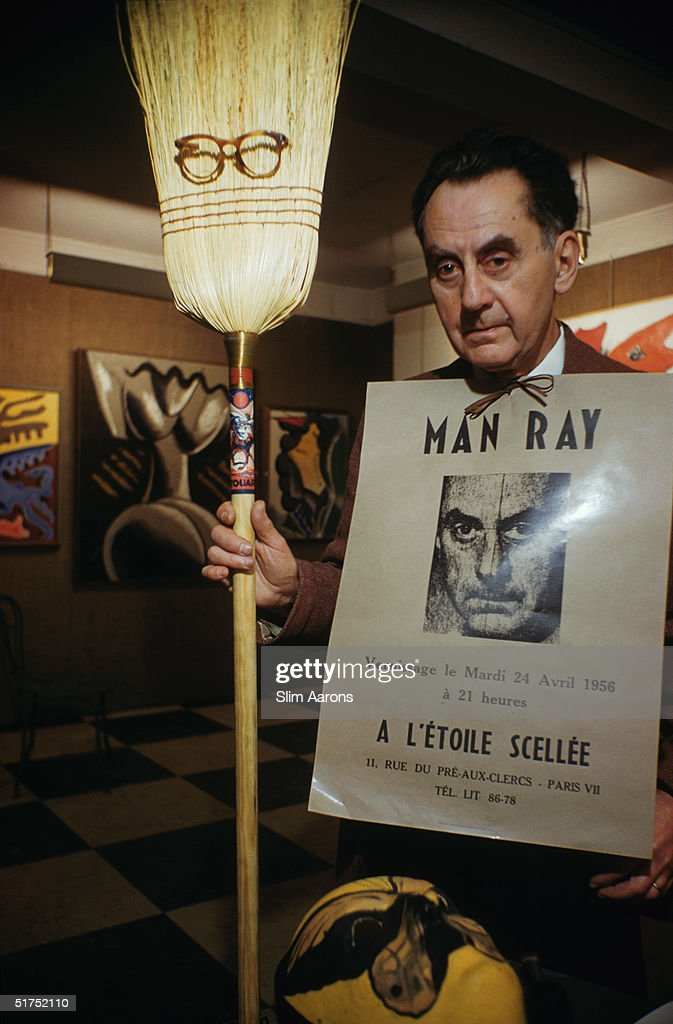 American surrealist artist and photographer <a gi-track='captionPersonalityLinkClicked' href=/galleries/search?phrase=Man+Ray&family=editorial&specificpeople=13641952 ng-click='$event.stopPropagation()'>Man Ray</a> (1890 - 1976) with some examples of his work at his Left Bank studio in Paris, April 1956.