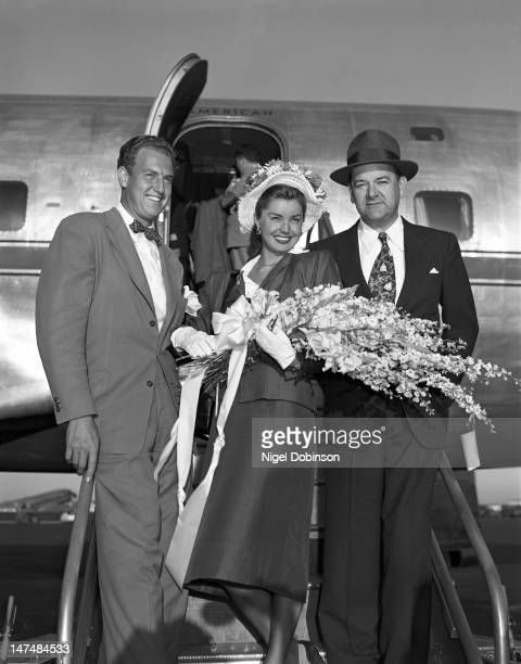 American swimmer and actress Esther Williams poses with her husband radio personality Ben Gage and the president of American Airlines Cyrus Rowlett...