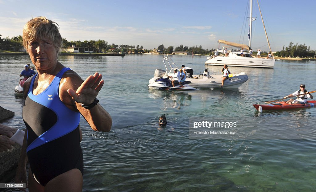 American swimmer Diana Nyad prepares her jump before starting her fifth try of swimming across the Florida Strait on August 31 2013 in Marina...
