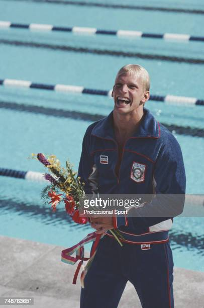 American swimmer Steve Lundquist of the United States team celebrates after finishing in first place in a world record time to win the gold medal in...