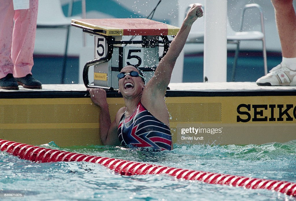 American swimmer Summer Sanders winning one of her four medals in the 1992 Barcelona Olympics. | Location: Barcelona, Spain.