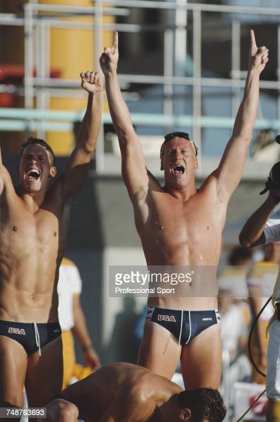 American swimmers Mike Heath and David Larson celebrate after the United States team of Mike Heath David Larson Jeff Float and Bruce Hayes finished...