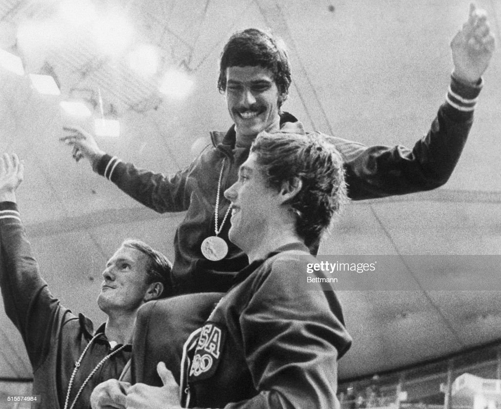 American swimmers Tom Bruce (left) and Mike Stamm (right) carry teammate Mark Spitz on their shoulders during the medal ceremony for their victory in the men's 4x100-meter medley relay race at the 1972 Summer Olympics in Munich, West Germany. The victory gave Spitz his seventh gold in the same Olympics. September 4, 1972.