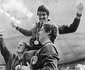 American swimmers Tom Bruce and Mike Stamm carry teammate Mark Spitz on their shoulders during the medal ceremony for their victory in the men's...