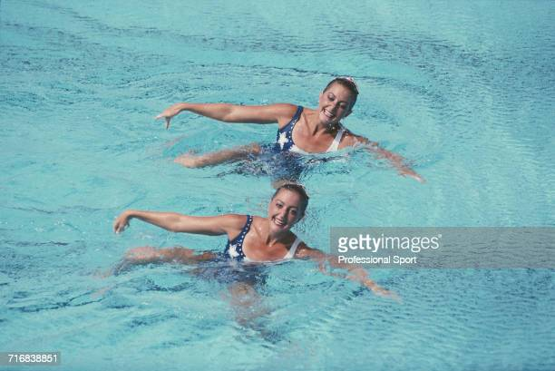 American synchronised swimmers and sisters Karen Josephson and Sarah Josephson compete for the United States team to finish in first place to win the...