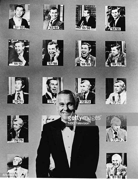 American talk show host and comedian Johnny Carson wears a tuxedo and poses in front of portraits of him from his first twenty years as host of the...