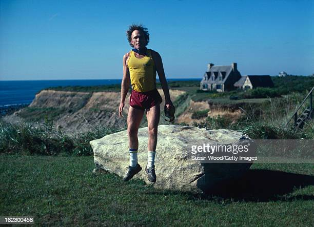 American talk show host and writer Dick Cavett jumps in the air in the Hamptons Long Island New York September 1984
