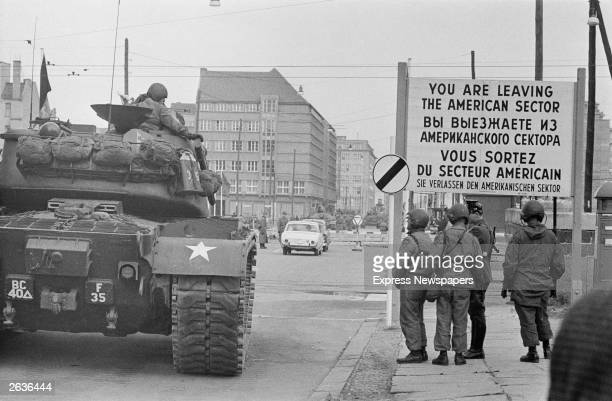American tanks and troops at Checkpoint Charlie a crossing point in the Berlin Wall between the American and Soviet sectors of the city at the...