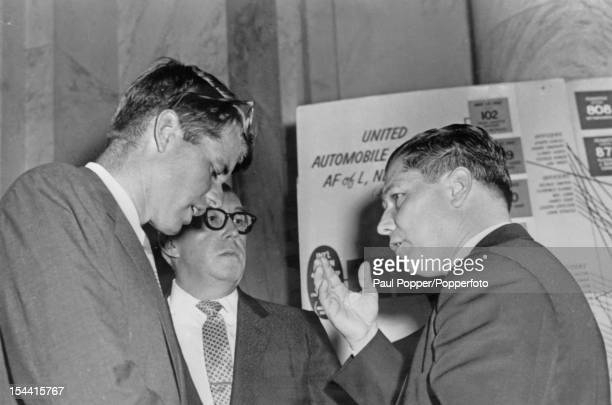 American Teamsters union Vice President Jimmy Hoffa talks to his attorney George Fitzgerald and Robert F Kennedy during a break in a hearing of the...