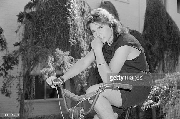 American television and film actor Corey Feldman poses on a bmx bike for a magazine shoot United States circa 1985