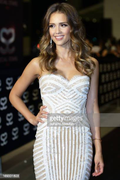 American television and film actress and model Jessica Marie Alba pose for photographers on the red carpet during the Social Star Awards 2013 at...