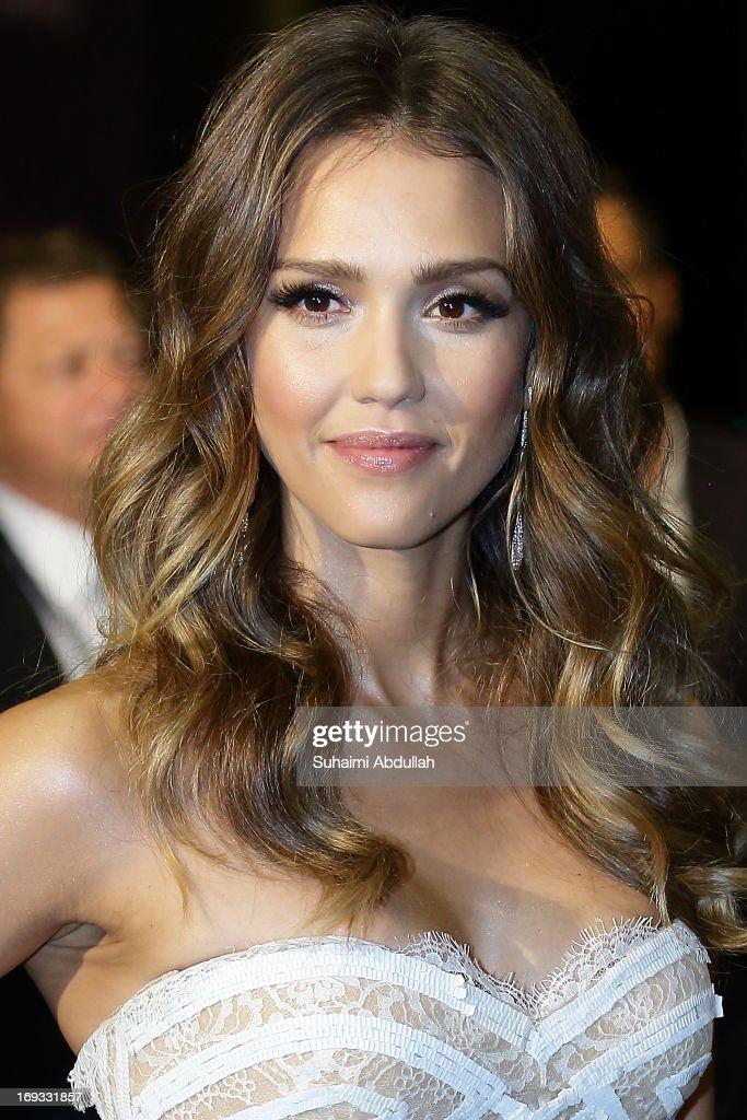 American television and film actress and model, Jessica Marie Alba pose for photographers on the red carpet during the Social Star Awards 2013 at Marina Bay Sands on May 23, 2013 in Singapore.
