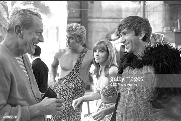 American television director David McDearmon talks to actor Bob Denver on the set of the episode 'Our Vines have Tender Apes' of the CBS sitcom...