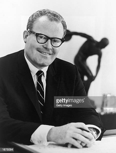 American television executive at ABC News and Sports Roone Arledge born in 1931 poses in his office with a replica of 'The Discus Thrower' sculpture...