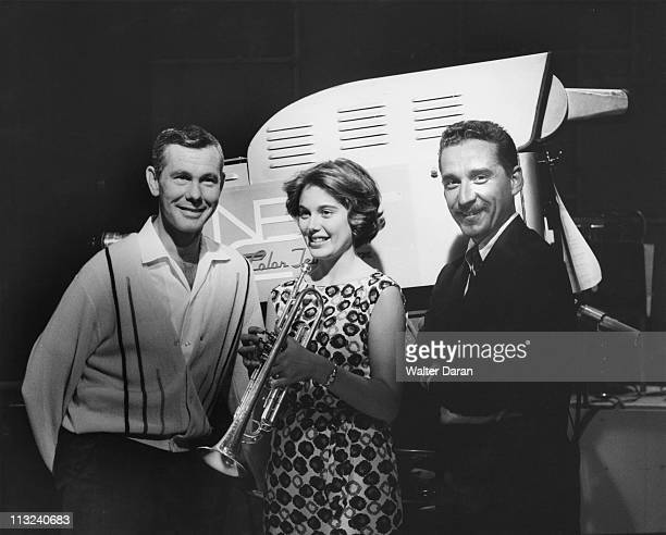 American television host and comedian Johnny Carson with an unknown woman and jazz trumpeter and 'The Tonight Show's orchestra leader Doc Severinsen...