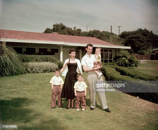 American television host and comedian Johnny Carson with his first wife Jody Wolcott and their sons Christopher Richard and Cory at their home in...
