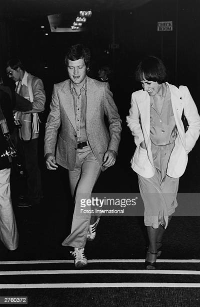 American television host David Letterman walks with an unidentified woman attending a SHARE party at the Hollywood Palladium Hollywood California May...