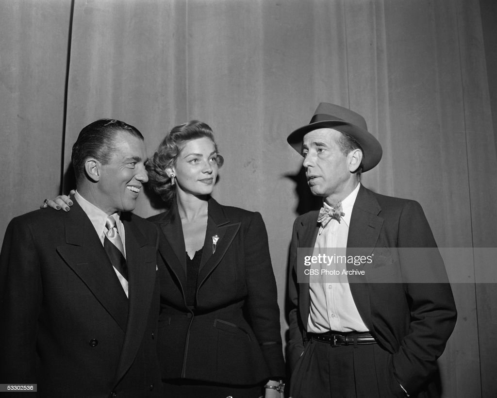 American television host Ed Sullivan (1902 - 1974) talks with actors Lauren Bacall and Humphrey Bogart (1899 - 1957) on the set of the CBS weekly variety show 'Toast of the Town,' New York City, New York, October 14, 1951.