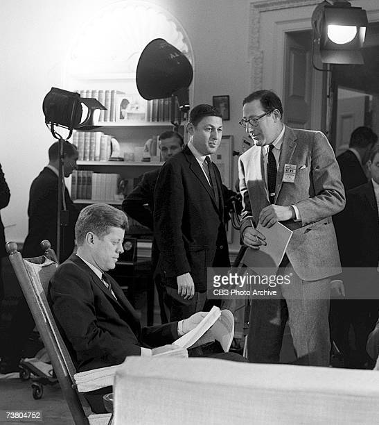 American television news producer Fred Friendly born Ferdinand Friendly Wachenheimer holds documents and waits while American president John F...