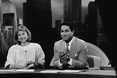 American television personalities Jane Pauley and Bryant Gumbel sit at their desk as they host the NBC morning news program 'Today' in New York May...