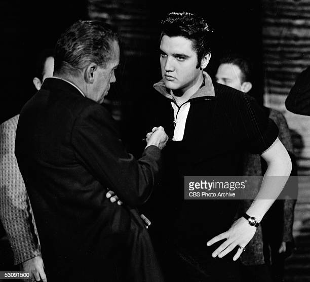American television personality Ed Sullivan talks with singer and musician Elvis Presley backstage at 'The Ed Sullivan Show' Los Angeles California...