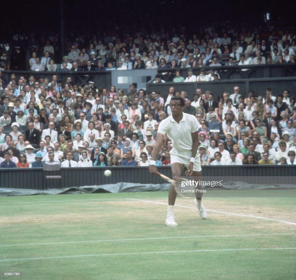 American tennis champion Arthur Robert Ashe Jnr (1943 - 1993), the first black player to win a major men's tennis tournament, on court at Wimbledon.