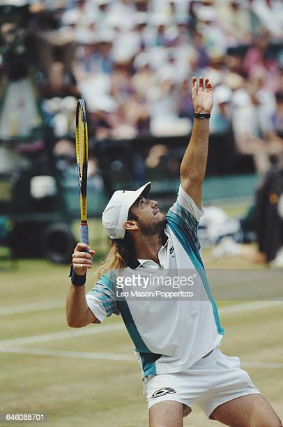 American tennis player and defending champion Andre Agassi pictured in action competing to reach the quarterfinals in the Men's Singles tournament at...