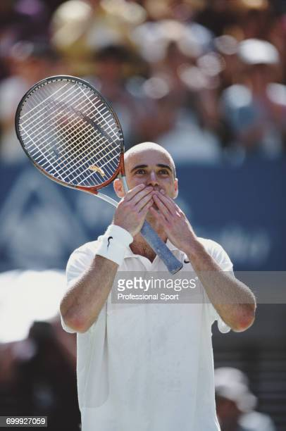 American tennis player Andre Agassi pictured blowing a kiss to fans in celebration after defeating Russian tennis player Yevgeny Kafelnikov 36 63 62...