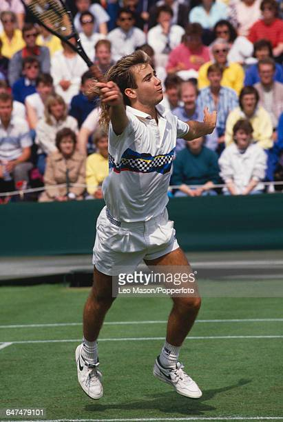 American tennis player Andre Agassi pictured in action competing in the first round in the Men's Singles tournament at the Wimbledon Lawn Tennis...