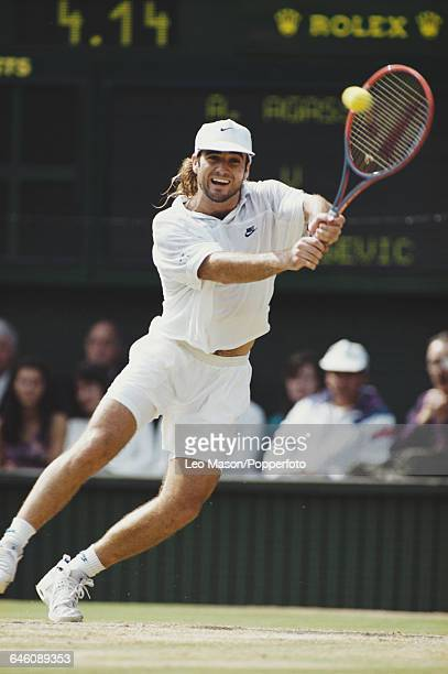 American tennis player Andre Agassi pictured in action competing to win the final of the Men's Singles tournament against Goran Ivanisevic at the...