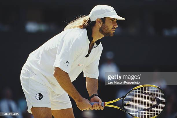 American tennis player Andre Agassi pictured in action competing to reach the fourth round of the Men's Singles tournament at the Wimbledon Lawn...