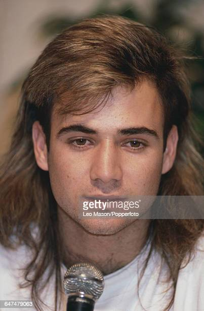 American tennis player Andre Agassi pictured sporting his distinctive mullet hairstyle at a press conference in the United States in January 1989