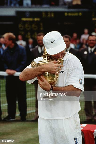 American tennis player Andre Agassi with the trophy after winning the the Men's Singles Final at Wimbledon 5th July 1992 Agassi beat Goran Ivanisevic...