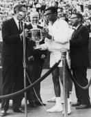 American tennis player Arthur Ashe accepts the trophy after winning the inaugural US Open Championship at Forest Hills New York 9th September 1968...
