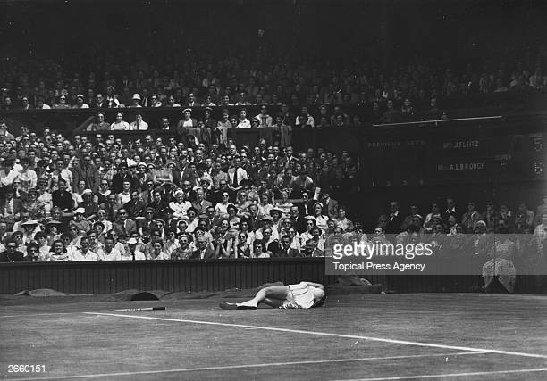 American tennis player Beverly Fleitz lying on the ground after falling during the women's singles final against Louise Brough at Wimbledon Brough...