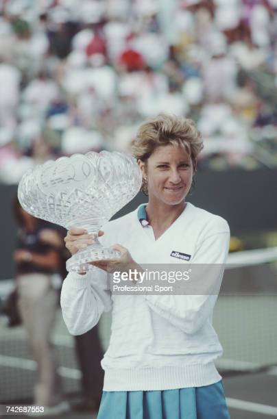 American tennis player Chris Evert pictured holding the winner's crystal glass bowl after winning the Women's Singles tennis tournament at the 1986...
