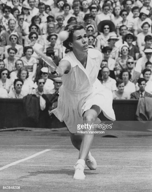 American tennis player Doris Hart in action against Maureen Connolly of the US during the finals of the Women's Singles on the Centre Court at...