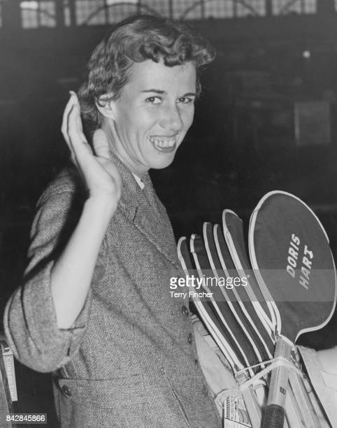 American tennis player Doris Hart with her personalised racket case at Waterloo Station in London whilst waiting for the 'Queen Mary' boat train to...
