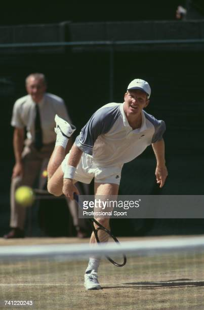 American tennis player Jim Courier pictured in action against Pete Sampras in the final of the Men's Singles tournament at the Wimbledon Lawn Tennis...